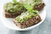 image of pesto sauce  - whole grain bread with fresh basil pesto - JPG