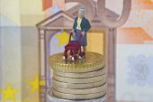 picture of rollator  - Figurine from senior and euro coins and banknote background - JPG