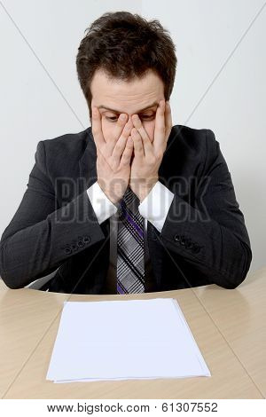 Worried young businessman over a document
