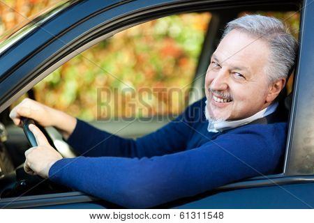 Mature man driving his car