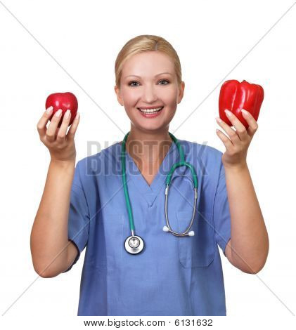 Young Pretty Female Holds Red Apple And Pepper