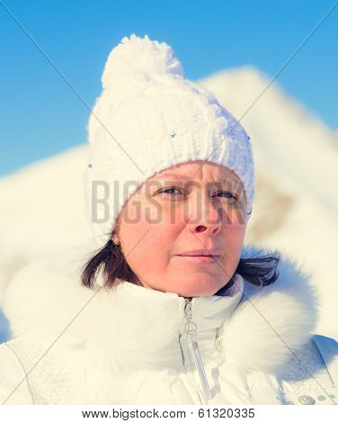 The Woman Of Average Years In A White Knitted Cap