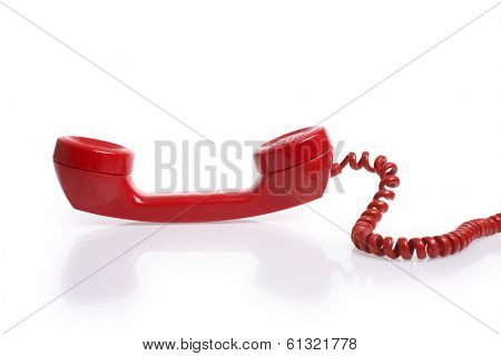 Red telephone reciever on white background
