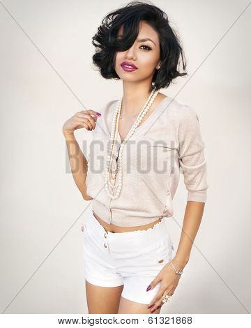 Beautiful exotic young fashionable woman with short dark hair