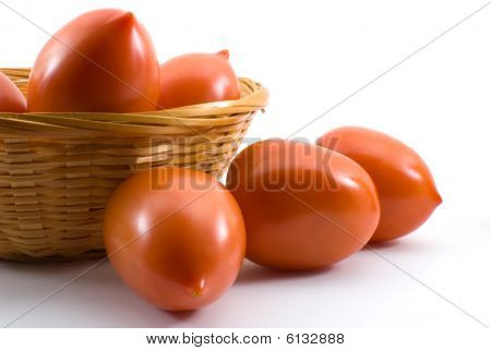 Fresh Plum Tomatoes In A Basket Isolated On A White Background