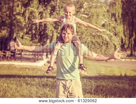 Family Father Man And Son Boy Sitting On Shoulders Outdoor Happiness Emotions Lifestyle With Summer