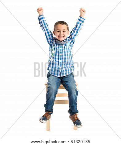 Lucky Boy On A Wooden Chair Over White Background