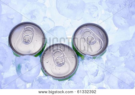 green Cans of Beer in Ice Cubes