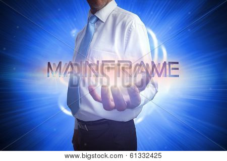 Businessman presenting the word mainframe against background with shiny ball