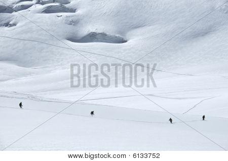 4 Skiers On A Glacier