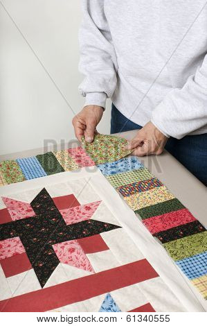 Placing Cornerstone For Quilt Top Border.