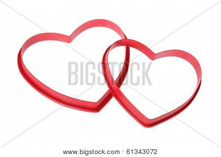 two red heart shaped cookie cutters on white