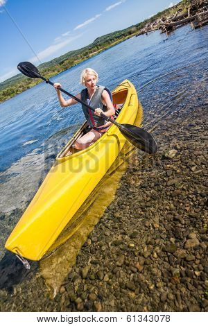 Calm River And Woman Kayaking In Gaspe, Quebec, Canada