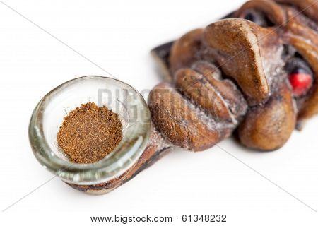 Slice Of Hashish In Smoking Pipe