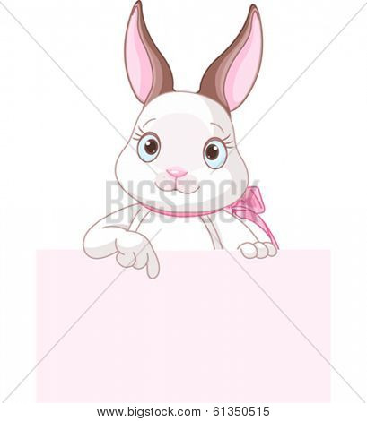Cute cartoon bunny rabbit peeking round from behind a sign and pointing down