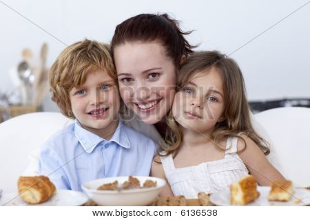 Children And Mother Having Breakfast