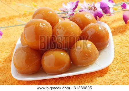 sweet balls called gulab jamun an indian sweet in a dish