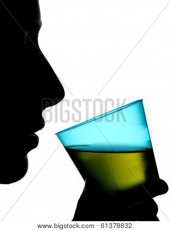 Silhouette Of A Woman Holding A Glass Of Green Drink