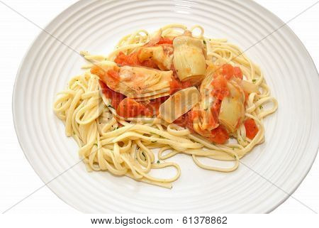 Pasta With Tomatoes And Artichokes As A Healthy Dinner