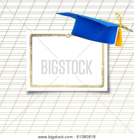 Mortar Board Or Graduation Cap With Paper Leaf  On The Background Notebook Sheet