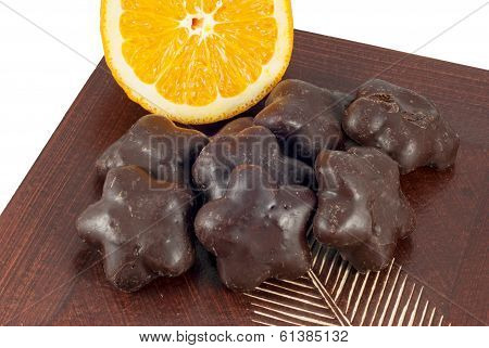 Gingerbread Cakes And Slice Of Orange On Wooden Table.