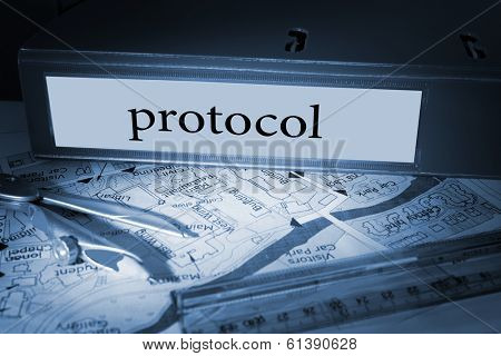The word protocol on blue business binder on a desk