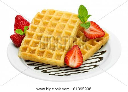 belgium waffles with strawberries and mint on plate isolated on white