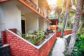 stock photo of guest-house  - Guest house near the road in tropical greenery village of Kovalam Kerala India - JPG