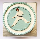 picture of karate  - Birthday cake decorated with karate silhouette in blue and white on gray background - JPG