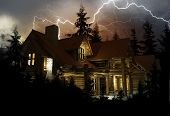 stock photo of lightning  - Log Home in the Middle of the Forest During Heavy NIght Time Lightning Storm - JPG
