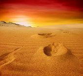 stock photo of sahara desert  - Beautiful sunset over the sand dunes in the Sahara desert - JPG