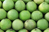 picture of pomelo  - Pile of the pomelo on market tray - JPG