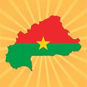 Burkina map flag on sunburst vector illustration