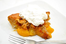 picture of doughy  - Serving of Peach Cobbler on a White Plate - JPG