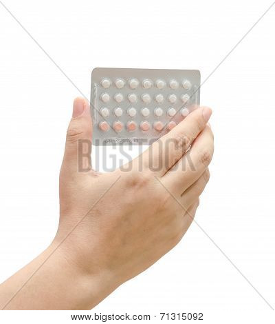 Woman Hand Holding Contraceptives pill