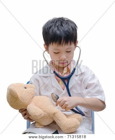 Young Asian Doctor Boy Playing And Curing Bear Toy