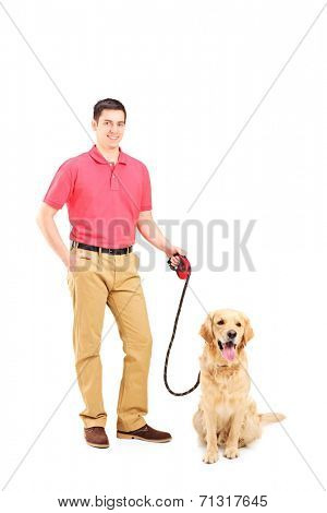 Young man holding a dog on a leash isolated on white background