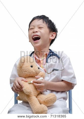 Asian Doctor Boy Playing And Cure  Bear Toy Isolated