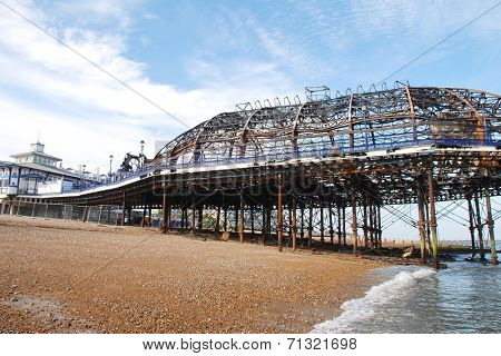 EASTBOURNE, ENGLAND - JULY 31, 2014: The Victorian pier which was badly damaged by fire on July 30, 2014. Designed by Eugenius Birch, the landmark was first opened in 1870.