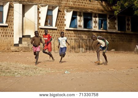 TORIT, SOUTH SUDAN-FEBRUARY 20 2013: Unidentified boys play football in the town of Torit, South Sudan