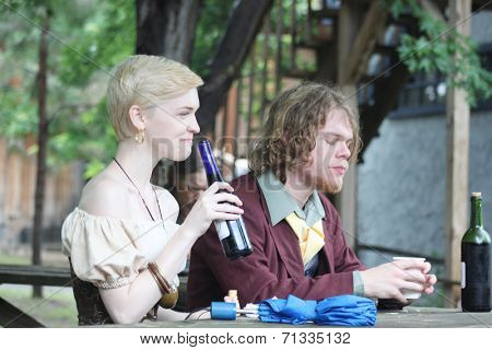 MUSKOGEE, OK - MAY 24: A couple of festival goers enjoy a drink during the Oklahoma 19th annual Renaissance Festival on May 24, 2014 at the Castle of Muskogee in Muskogee, OK