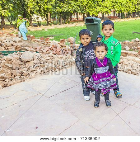 Group Of Indian Children Smiles And Poses  For Camera