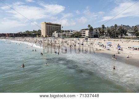 VENTURA, CALIFORNIA - August 31, 2014:  Summer holiday crowds enjoying the Pacific ocean at Ventura Beach in Southern California.