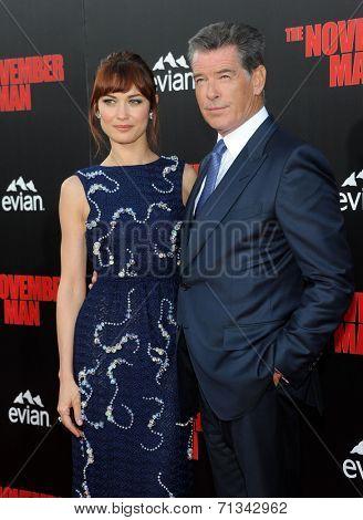 LOS ANGELES - AUG 13:  Olga Kurylenko & Pierce Brosnan arrives to the