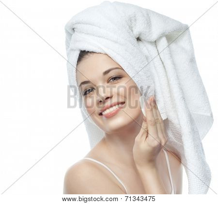closeup portrait of attractive  caucasian smiling woman brunette isolated on white studio shot  toothy smile face  head and shoulders looking at camera towel tube on head body care scrub glove