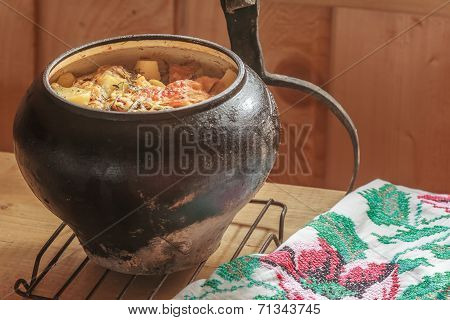 Traditional stew meal cooked in wood-fired oven