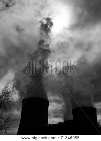 Cooling towers of a nuclear power plant creating dark clouds