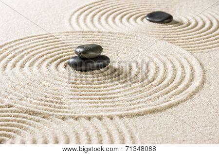 A japanese zen garden with black pebbles