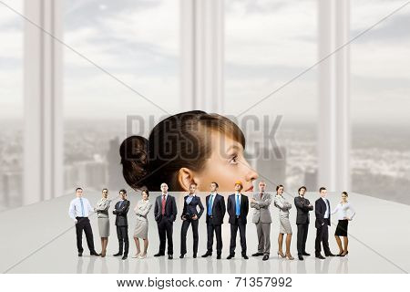 Businesswoman looking from under the table at businessteam