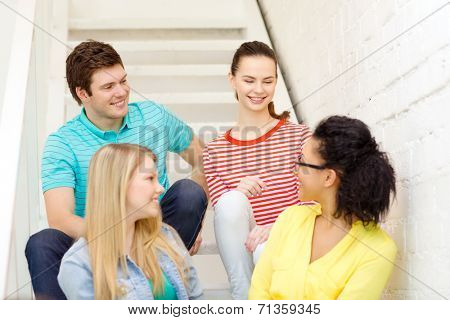 frienship and education concept - smiling teenagers hanging out